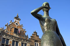 Statue and historic building in center Nijmegen. Netherlands: On the square Grote Markt is placed the bronze statue of Mariken of Nieumeghen, the protagonist of Stock Photography