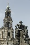 Statue in Historic Dresden. Statue and the Tower of the Catholic Church of Dresden Royalty Free Stock Image