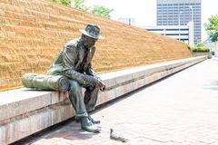 Statue of Hobo Feeding Pigeon Royalty Free Stock Image