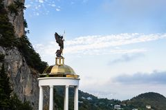 Statue of Holy Archangel Michael in Oreanda. Travel to Crimea - view of statue of Holy Archangel Michael on pavilion at the foot of Mount Ai-Nicolas in Oreanda Stock Image