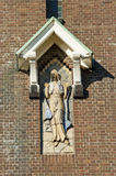 Statue of holy Mary on Church tower Royalty Free Stock Photography