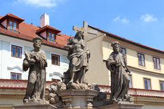 Statue of the Holy Savior with Cosmas and Damian at Charles Bridge, Prague Royalty Free Stock Image
