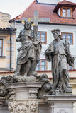 Statue of the Holy Savior with Cosmas and Damian on Charles Bridge in Prague Royalty Free Stock Images