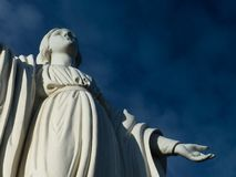 Statue of the holy virgin mary at cerro san cristobal in Santiago de chile creating a diagonal stock photo