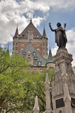 Statue honoring the Recollets in front of the Fairmont Le Chateau Frontenac Stock Photography