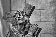 Statue of Jesus carrying the cross Stock Photos
