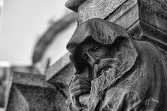 Statue of hooded old man with beard Stock Photos