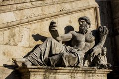 Statue with horn of plenty at Piazza del Campidoglio in Rome Stock Images