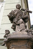Statue on the hotel building at stairs to the Prague Castle. PRAGUE, CZECH REPUBLIC Stock Images