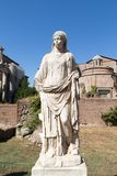 Statue at House of the Vestals in the archaeological site of the Imperial Forums royalty free stock photography