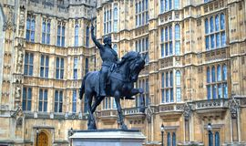Statue in the houses of parliament, London. The Palace of Westminster is the meeting place of the House of Commons and the House of Lords, the two houses of the Stock Images