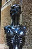 Statue of HR Giger cafe with his biomechanical style royalty free stock photo