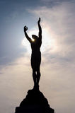 Statue icarus. Icarus statue backlit with arms outstretched Stock Photo