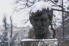 Statue im Schnee Stockbild