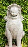 Statue im Stein eines Hundes Lizenzfreie Stockbilder