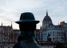 Statue of Imre Nagy and hungarian parliament Stock Images