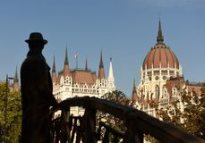 Statue of Imre Nagy and Parliament Building in Budapest, Hungari. Statue of Imre Nagy and Parliament Building in Budapest, Hungary Royalty Free Stock Images