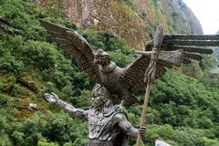 Statue of the Inca Cosmological Trilogy at the town of Aguas Calientes or Machupicchu Pueblo, Cusco, Peru. Statue of the Inca Cosmological Trilogy at the town of royalty free stock images