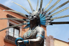 Statue of  indian in the colonial city, Mexico. Stock Images