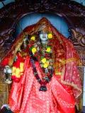 Statue indoue de Parvati sur un autel Photo stock