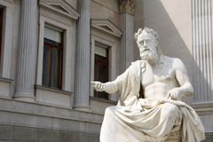Statue infront of the Austrian Parliament. Greek Statue as a symbol of democracy Royalty Free Stock Image