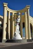 A statue inside a half-rotunda Stock Images