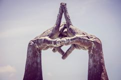 Statue with Interlocked Hands in Park Stock Images