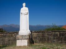 Statue of Italian writer Dante, in Mulazzo village, north Tuscany. Stock Photos