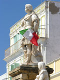Statue in Italy holding Italian flag Royalty Free Stock Photo
