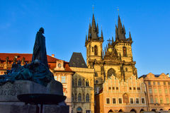 The statue of Jan Has with the Church of Our Lady before Týn, a gothic church and a dominant feature of the Old Town of Prague. The statue of Jan Has with Royalty Free Stock Image