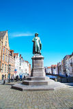 Statue of Jan Van Eyck and people at the street in Bruges, Belguim Stock Photography