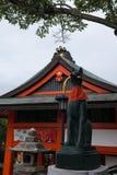 Statue of a Japanese fox Kitsune in the Fushimi Inari Shinto Shrine. Kyoto, Japan Royalty Free Stock Images