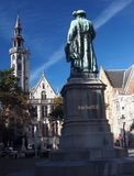 Statue Jean Van Eyck Square Bruges Belgium. Statue of Jean Van Eyck in Square Bruges Belgium  Europe   surrounded by medieval buildings Royalty Free Stock Image