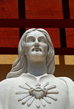Statue of Jesus. Marble statue of Jesus Christ with overhead lighting casting interesting shadows behind Royalty Free Stock Image