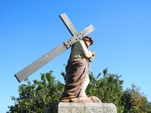 Statue of Jesus Christ carrying cross Royalty Free Stock Photo