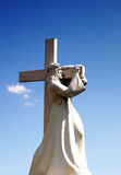 A statue of Jesus Christ carrying his cross. Jesus Christ going royalty free stock photos