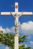 A statue of Jesus Christ, crucified against blue sky Stock Image