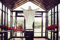 A statue of Jesus Christ inside the glass sanctuary in the garden of the Casey Solanus Center. Detroit, USA - October 2nd, 2016: A statue of Jesus Christ inside royalty free stock images