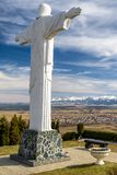 Statue of Jesus Christ at Klin, Slovakia. Monumental statue of Jesus Christ at Klin in Slovakia. Region Orava and High Tatras at background stock image