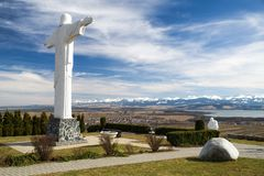 Statue of Jesus Christ at Klin, Slovakia. Monumental statue of Jesus Christ at Klin in Slovakia. Region Orava and High Tatras at background royalty free stock photo