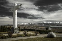 Statue of Jesus Christ at Klin, Slovakia. Monumental statue of Jesus Christ at Klin in Slovakia. Region Orava and High Tatras at background royalty free stock image