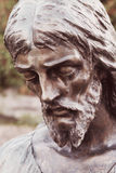 Statue of Jesus Christ in sorrow Christianity, faith, pain Royalty Free Stock Images