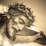 Statue of Jesus Christ. The suffering of Jesus Christ. Details of the bronze statue. Sepia tone stock photography