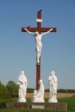 Statue of Jesus Christ on wood cross Stock Images