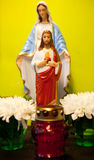 A statue of jesus and flowers Royalty Free Stock Photos