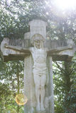 Grave statue with frontlighting. A statue of jesus with frontlighting Royalty Free Stock Images
