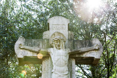 Grave statue with frontlighting Royalty Free Stock Photo