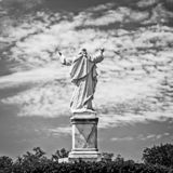 Statue of Jesus with Hands Raised. New Orleans, LA USA - May 9, 2018 - Statue of Jesus with Hands Raised at Loyola University in B&W royalty free stock image
