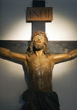 Statue of Jesus hanging on a cross Royalty Free Stock Photos