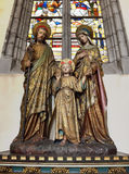 Statue of Jesus with his parents Saint Joseph and Mary in Saint-Martin's Church of Courtrai. COURTRAI, BELGIUM-FEBRUARY 22, 2014: Statue of Jesus with his Stock Images